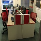 driftwood desking with light grey legs and red edging
