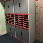 tambour cupboard with centre pigeon hole system