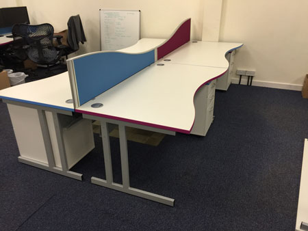 desks trimmed in company colours